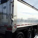 mac tri axle dump rear view